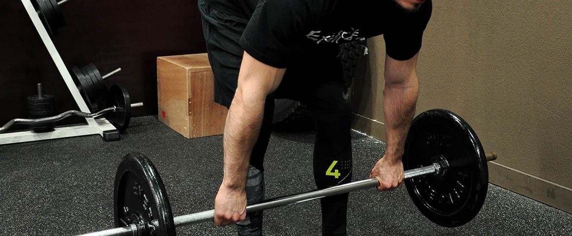 Soulevé de terre jambes tendues - Stiff-legged barbell deadlift
